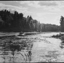 Image of 4838 - Ken Unger in the taxi boat on the Madawaska River