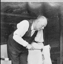 Image of 1937 - Ken Unger re-canvasing a canoe