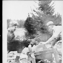 """Image of 4889 - Cook's helpers with """"their nose to the grindstone""""."""