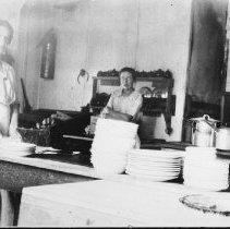 Image of 5078 - Lizzie Dennison (L) in the kitchen at Hotel Algonquin, Joe Lake