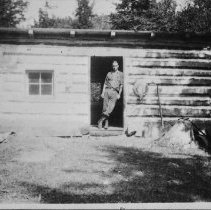 Image of Phil Boyle at George Pearson's shack, across the tracks at Rock Lake
