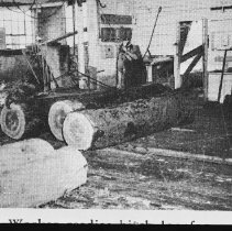 Image of 5112 - A worker readies a birch log for barking and cleaning at Staniforth's Mill
