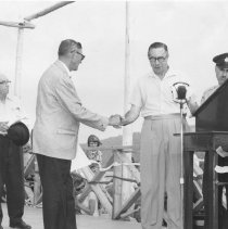 Image of 1964 - Mr. Dan Stringer is presented with the 'Order of the Chieftains of Algonquin' by the Hon. A. Kelso Roberts, Q.C., Minister of Lands & Forests, at Lake of Two Rivers, July 11, 1964.