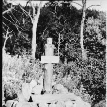 """Image of 1929 - Monument """" to the tin can"""", because the tin can supplied all their food, erected by the fish lab. staff on the portage between Smoke and Ragged Lakes, 1929."""