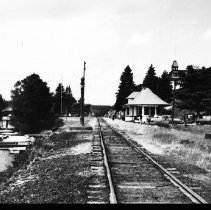 Image of 5600 - The railway station at Cache Lake, with the Highland Inn in the background.