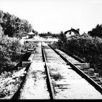 Image of 5603 - The railway station and section house at Rock Lake.