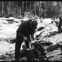 "Image of 5669 - Felix Luckasavitch building a log shanty at Achray, for the N.F.B. film ""The Winter My Mother Died"", 1980."