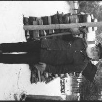 """Image of 5682 - Henry Taylor, holding a shovel and an axe over his shoulder like a """"chickadee"""", Bancroft, 1979."""