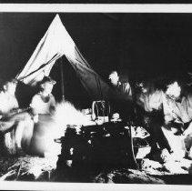 Image of 5699 - Sitting around the campfire.