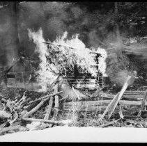Image of 5789 - Burning an old lumber camp, Misty Lake April 12, 1961.