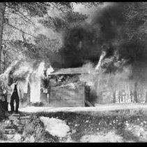 Image of 5805 - burning ranger cabin at North Tea Lake