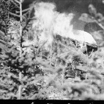 Image of 5810 - burning ranger cabin at Thomson Lake