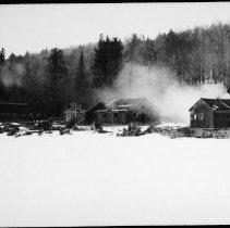 Image of 5816 - burning lumber camp at Misty Lake