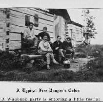 Image of 5982 - Camp Waubuno campers enjoy a rest at a fire ranger's cabin