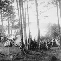 Image of 5992 - Council fire and reading ('camp chat') at Camp Northway (Cache Lake)