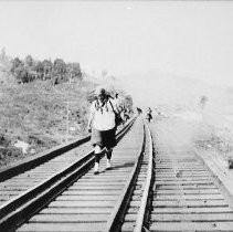 Image of 6005 - Tenny Jarvis, crossing the third trestle, (between Two Rivers and Cache Lake)