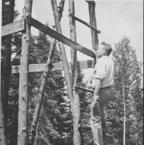 Image of 1949 - J. Bruce Falls climbing observation tower