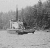 Image of 6258 - Steam tug pulling cribs of hardwood logs