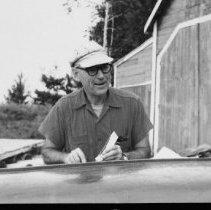 Image of 6430 - Jack Wilkinson fixing canoe