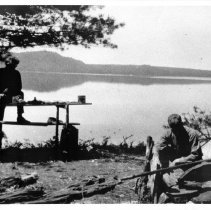 Image of Camping on Crow Lake, coaxing the fire to burn.