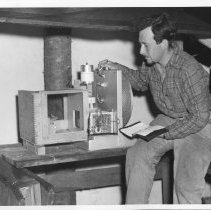 Image of 1948 - Bruce Falls Measuring and Recording the Activity of a Chipmunk to Determine Climatic Effect