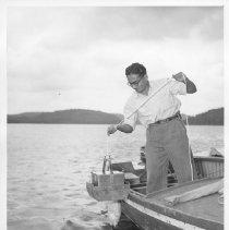 Image of 4530 - Vasanth Rao with Eckman Dredge, Opeongo fish lab.