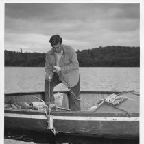 Image of June 1955 - Using a water sampling bottle, Opeongo fish lab.