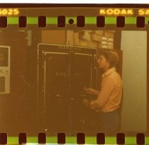 Image of Rick Scott standing in front of the safe at the Mizpah Hotel and Casino - ca. 1976