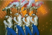 Image of Performers Diana, Heidi, Jeanne, and Kim with the Folies Bergere - ca. 1990s