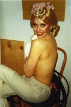 Image of Female performer with the Folies Bergere stage show changing clothes - ca. 1980s