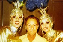 Image of Unknown man with two female performers with Folies Bergere - ca. early 1980s