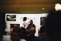Image of Makeup demonstration at Macy's, Fashion Show Mall, in conjunction with Star Trek the Experience - February 7, 1998