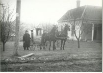 Image of Harlan Waltz with mail wagon and horses