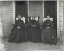 Image of Women in rocking chairs