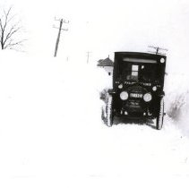 Image of Hero Honkavaara and his car in a snowstorm in the late 1920s