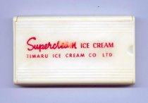 "Image of Brush, Clothes - Flat rectangular cream plastic case with sliding lid on top. Inside are 7 rows of nylon bristles open out when cover slides off. On lid in red is ""Supercream ICE CREAM / TIMARU ICE CREAM CO LTD."""