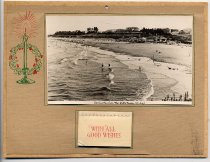 "Image of Calendar - Small calender for the year 1947. The backing is cardboard which has paper almost the same size attached. On the paper is a photographic print of Caroline Bay called ""Caroline Bay from the Cliffs Timaru N Z 4165"" Underneath this is attached a very small calender with the words "" With all Good Wishes"" in red and then each page has one month. On the side of the photo is a pen drawing in green and red of a candle and holly."