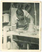 Image of [Ivan Ennis at work at Timaru Potteries] -