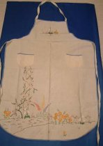 Image of Apron - Cream cotton apron with floral embroidery.
