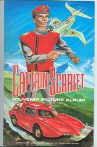 "Image of Album, Card - Album called ""Captain Scarlett Souvenir Picture Album"" into which cards collected from products of the Timaru Milling Company are kept. Album has front cover with  Captain Scarlet and ""Presented by Timaru Miling Company Ltd, Timaru, New Zealand"". Inside the folding album is an envelope with 20 ""Captain Scarlett"" cards, 6 ""1947 Peter the Pilot - Peace and Progress"" cards, and a piece of note paper with 1969 written on it.