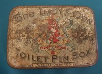 Image of Box, Pin - Small tin with 'The Lady's Own Toilet Pin Box'  and 'Short whites' written on the lid.  Lid has remains of other coloured decoration and originally held a quarter pound of best pins. The tin in rather poor condition.