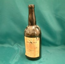 """Image of Bottle, Chemical - Brown glass bottle for domestic ammonia. Bottle has narrow neck. """"Williams & Humbert"""" and """"W & H 1877"""" is embossed on it. Paper label has """"Domestic Ammonia, Poisonous"""", """"Bottled by Golcrum Hayward Ltd, Christchurch, New Zealand"""", directions for use and an antidote if accidentally taken. Bottom of bottle has embossed """"Williams % Humbert, Jerez, 0.5, 68""""."""