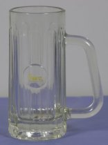 "Image of Glass - Clear glass beer mug with large handle, 10 ribbed indentations around the sides, one flat circular area with yellow stylised """"HANZ"""" in centre.