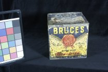 """Image of Tin, Biscuit - Bruces biscuit factory tin. Tin has remains of paper sticker with """"Bruces Super Wine Biscuits J R Bruce Ltd Timaru - the seal of purity"""" with a red seal in the centre. Lower part is yellow and top part is blue with wheat ears in between. Label on front only. On the lid is another similar label but which also has """"3/- will be allowed for this tin returned in good order and condition."""" and """"Retain Quality and crispness keep lid closed."""""""