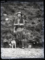 Image of [Unidentified man, with gun & dogs] - Clayton Station Collection