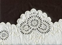 Image of Cover, Bolster - One of a pair of white cotton bolster cover with broderie anglaise at the ends.