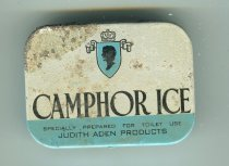 """Image of Jar, Cosmetic - Pale blue tin with hinged lid. On the lid is """"Camphor Ice """" in black and """"specially prepared for toilet use Judith Aden products"""". On the back is """" Camphor Ice an exquisite toilet article especially recommended for rough skin, chapped hands and lips etc Judith Aden products Wellington""""."""