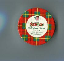 "Image of Tin - Circular red tartan patterned tin with ""Scotch brand cellulose tape N0 175 1 roll 1/2 x 792 in transparent"" in white centre circle. On the side is ""Pressure sensitive tape"" and ""the scotch brand"" and ""the plaid design are trademarks for pressure sensitive adhesive tape Made in Australia By Minnesota Mining and Mfg Aust Pty Ltd St Mary's NSW"""