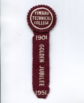 """Image of Pennant - Timaru Technical College Golden Jubilee pennant 1901 - 1951  Circular maroon felt badge (5cm diametre cut with pinking shears) with the words in white """"Timaru Technical College"""" and a rectangular strip of maroon felt underneath with the words in white """"Golden Jubilee"""" and dates 1901 and 1951.  A small gold safety pin at the back."""