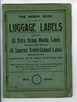 "Image of Label - Blue/green booklet with printed on the cover ""The handy Book of Luggage Labels containing 18 Extra Strong Manilla Labels with strings, 18 Superior Treble-Gummed Labels smartly printed. Complete with Good Blotting Pad. These Labels are all securely fixed in Book and perforated for immediate detachment, thus keeping them clean and in a compact and handy form.""